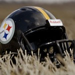 285px-Steelers_helmet_on_grass_field